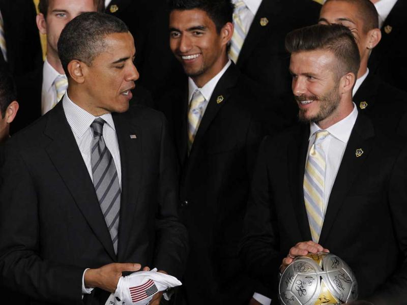 US President Barack Obama stands with Los Angeles Galaxy soccer player David Beckham (R) as he honoured the 2011 Major League Soccer champion Galaxy at the White House in Washington. AP Photo/Pablo Martinez Monsivais