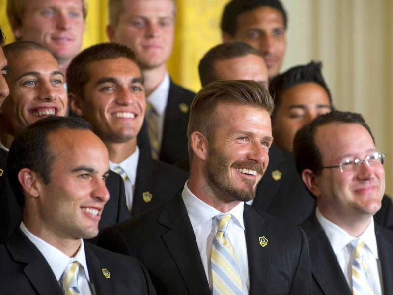 Players Landon Donovan (L) and David Beckham (C) laugh at a joke by US President Barack Obama alongside LA Galaxy teammates during an event in honour of their Major League Soccer (MLS) championship win in the East Room of the White House in Washington. AFP Photo/Saul Loeb