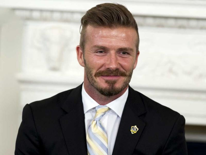 David Beckham speaks during a Let's Move soccer event hosted by First Lady Michelle Obama with players from the Los Angeles Galaxy, the Major League Soccer (MLS) champions, in the State Dining Room of the White House in Washington. AFP Photo/Saul Loeb
