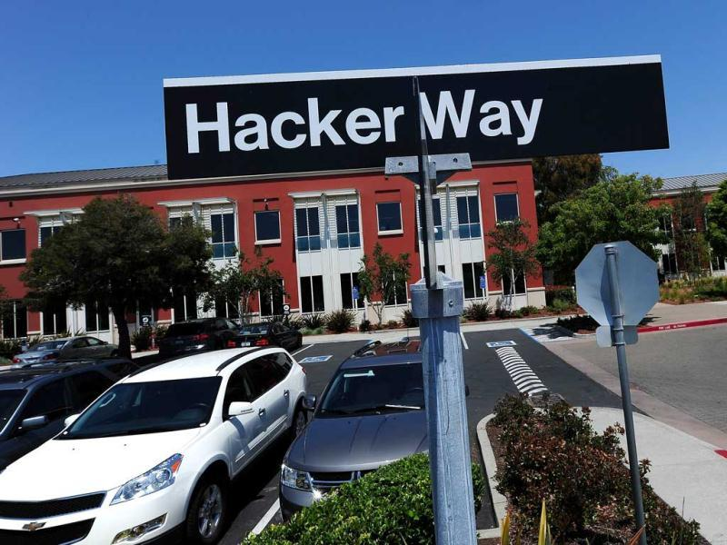 A street sign reading Hacker Way is seen in the parking lot of the Facebook headquarters in Menlo Park. AFP/Robyn Beck