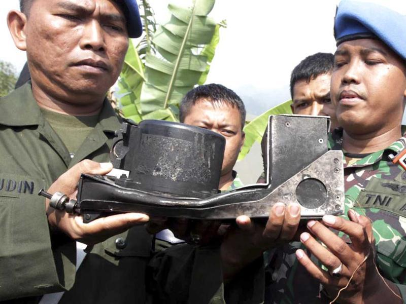 Indonesian soldiers hold the burnt cockpit voice recorder of a Sukhoi Superjet-100 that crashed into a mountain in West Java last week, during a press conference in Cijeruk, West Java, Indonesia. AP Photo