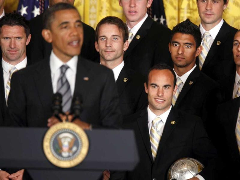 US President Barack Obama speaks in front of members of the 2011 Major League Soccer champions, Los Angeles Galaxy soccer team, in the East Room at the White House in Washington. Reuters/Larry Downing