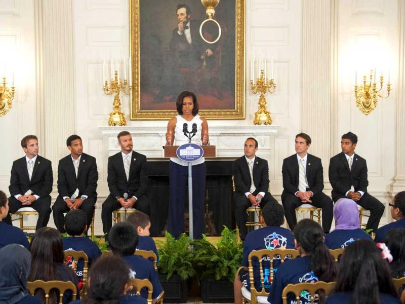 US First lady Michelle Obama speaks during a Let's Move soccer event with players from Major League Soccer (MLS) champions Los Angeles Galaxy in the State Dining Room of the White House in Washington. AFP Photo/Saul Loeb