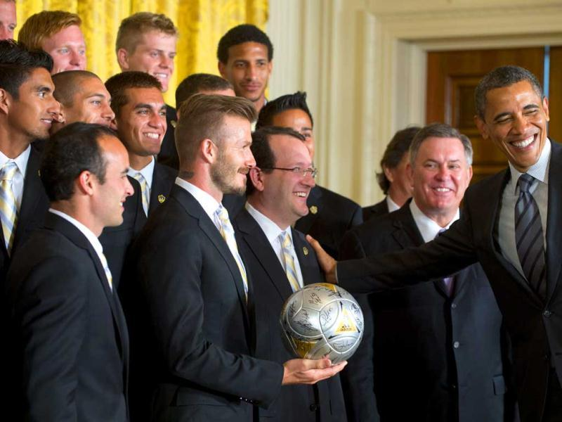 US President Barack Obama greets Major League Soccer (MLS) champions, including Landon Donovan (L) and David Beckham (2nd L), during an event in their honor in the East Room of the White House in Washington. AFP Photo/Saul Loeb