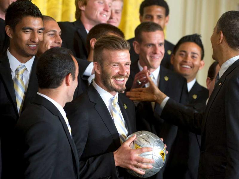 US President Barack Obama (R) greets players, including Landon Donovan (L) and David Beckham (2nd L) alongside members of the LA Galaxy during an event in honor of their win as Major League Soccer champions in the East Room of the White House in Washington, DC. AFP Photo/Saul Loeb