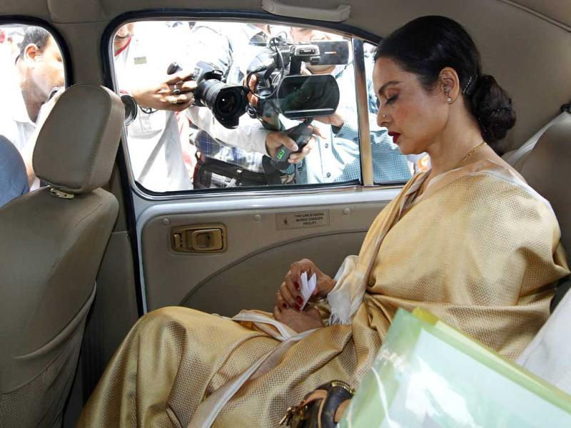 Rekha arrived at gate number 12 in MP Rajeev Shukla's official Ambassador car with him in the front seat and her secretary Farzana beside her, but seeing the rush, refused to step out till the car was taken to gate number 4 of Parliament.