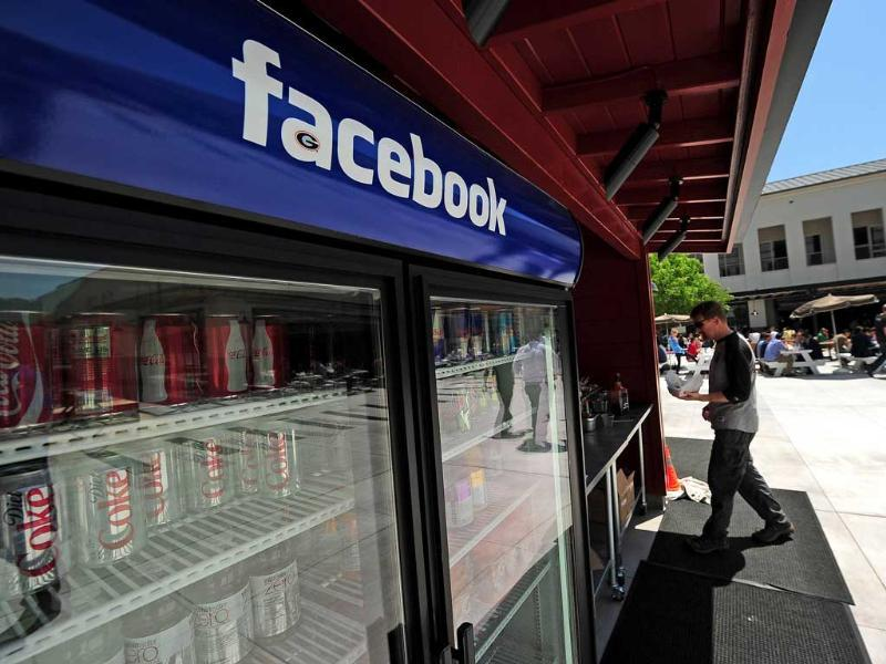 The Facebook name tops a beverage cooler at the headquarters of the world's most popular social networking website in Menlo Park, California. AFP/Robyn Beck