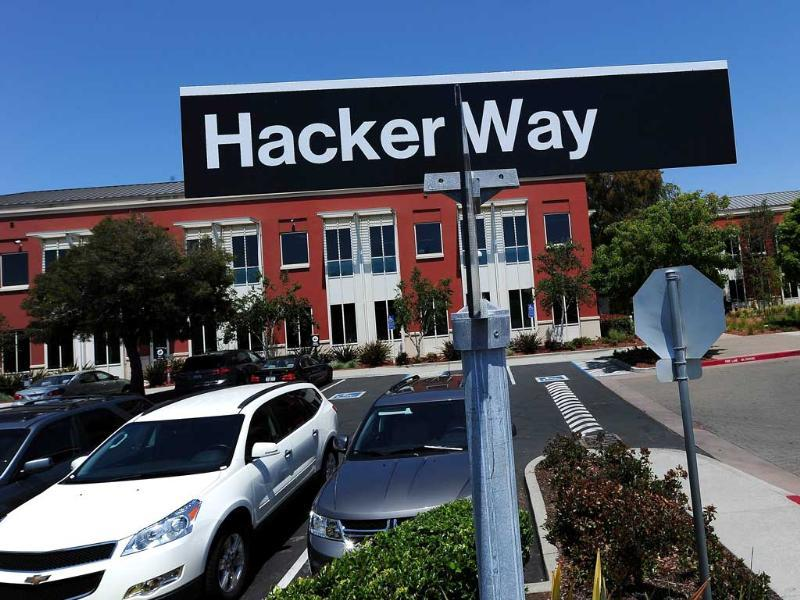 A street sign reading 'Hacker Way' is seen in the parking lot of the Facebook headquarters. AFP/Robyn Beck