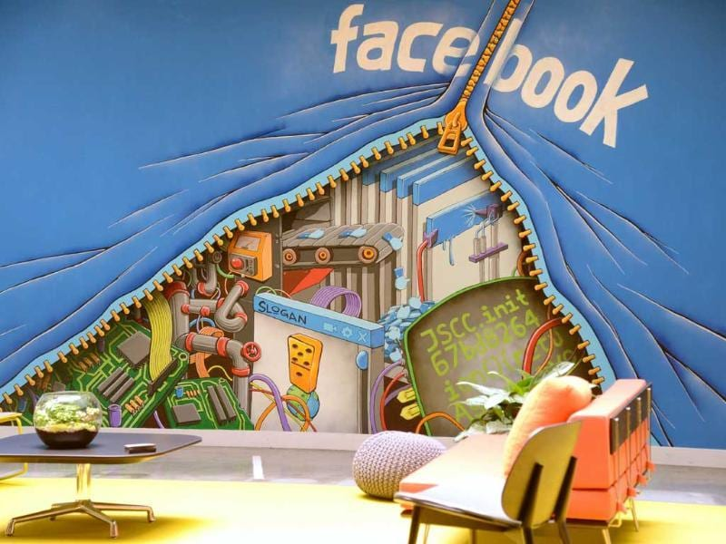 A mural decorates one of the many open space work areas at the Facebook headquarters. AFP/Robyn Beck