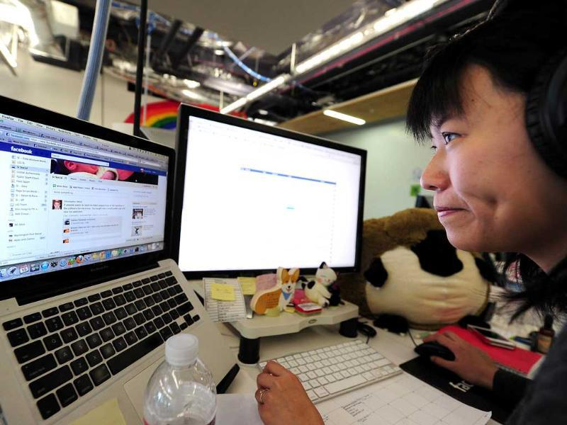 Facebook User Operations team member Kristie Chow checks a page of the number one social networking website at the Facebook headquarters in Menlo Park. AFP/Robyn Beck