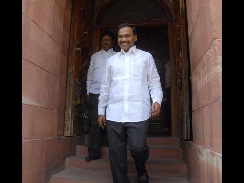 DMK leader and former telecom minister A Raja walks out after attending Parliament in New Delhi.