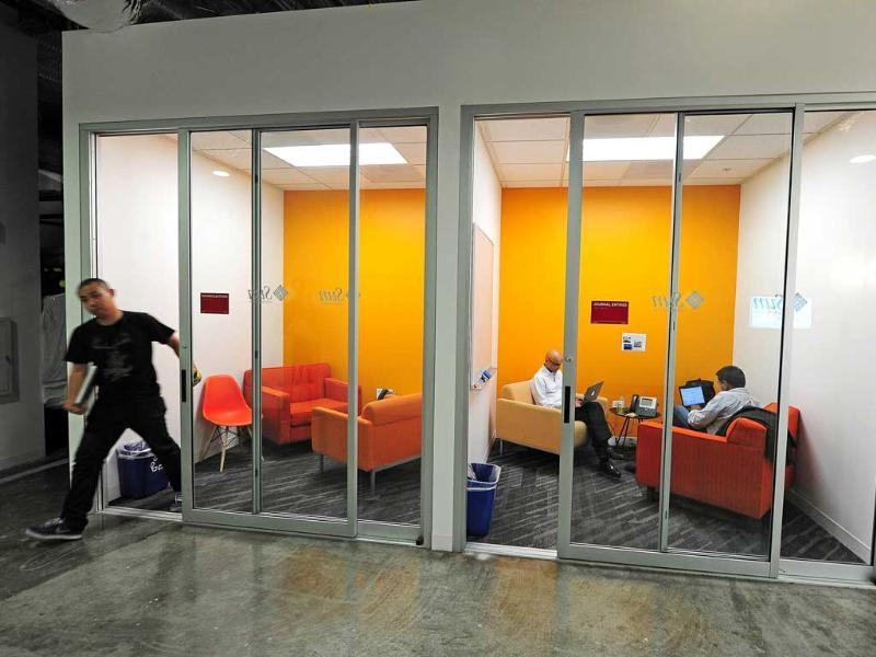 Facebook employees work in a communal work space at the Facebook main campus. AFP/Robyn Beck
