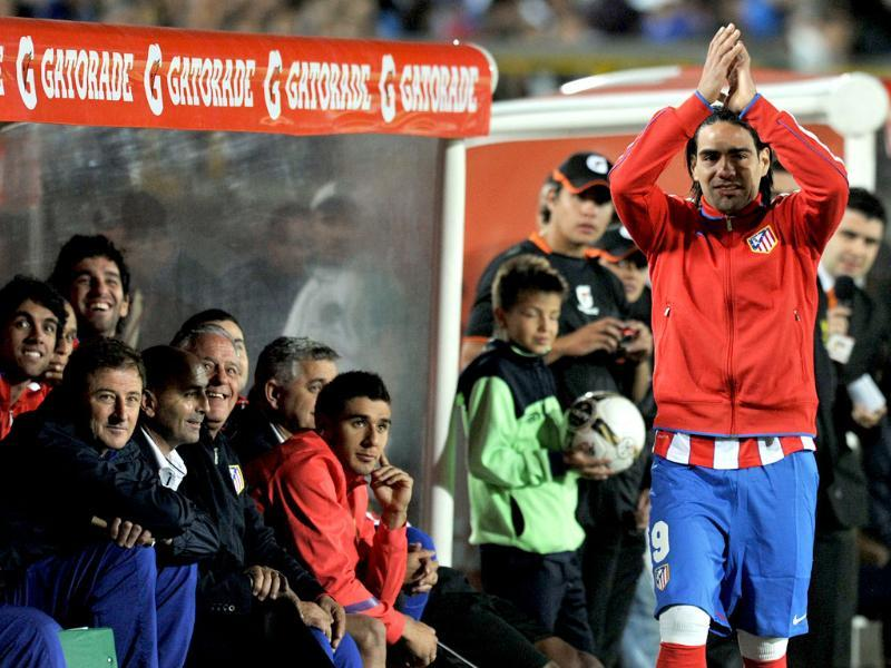 Colombian player Radamel Falcao of Spanish Atletico de Madrid waves to supporters after playing a friendly football match against Colombia's Millonarios held at Nemesio Camacho