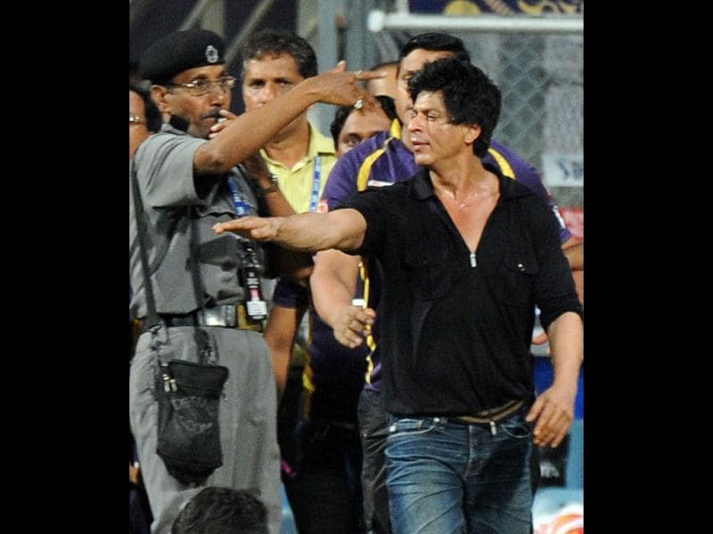 Bollywood actor and Indian Premier League franchise Kolkata Knight Riders co-owner Shah Rukh Khan reacts after a security guard directed children accompanying Khan, off the playing field after the IPL Twenty20 cricket match between Mumbai Indians and Kolkata Knight Riders at The Wankhede Stadium in Mumbai. AFP PHOTO/Indranil MUKHERJEE