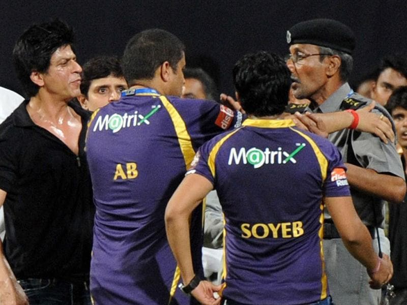 Bollywood actor and IPL franchise Kolkata Knight Riders co-owner Shah Rukh Khan reacts after a security guard directed children accompanying Khan, off the playing field after the IPL Twenty20 cricket match between Mumbai Indians and Kolkata Knight Riders at The Wankhede Stadium in Mumbai. AFP PHOTO/Indranil MUKHERJEE