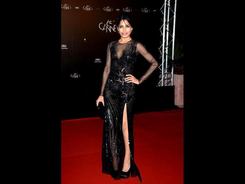Freida Pinto in a black Versace gown at the Opening Night Dinner of the Cannes Film Festival.