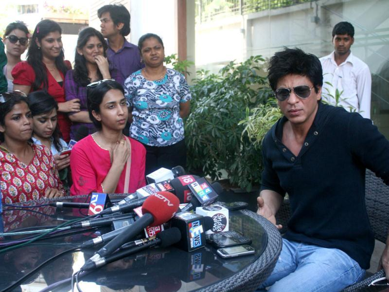 Bollywood actor Shah Rukh Khan addresses the media at his home in Mumbai. Shah Rukh Khan faced a police probe and a lifetime ban from Mumbai's main cricket stadium following a late-night row with staff at the ground. AFP Photo