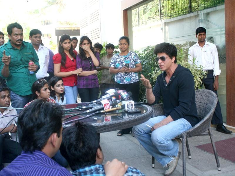 Bollywood actor Shah Rukh Khan addresses the media the media at his home in Mumbai. Shah Rukh Khan faced a police probe and a lifetime ban from Mumbai's main cricket stadium following a late-night row with staff at the ground. AFP Photo