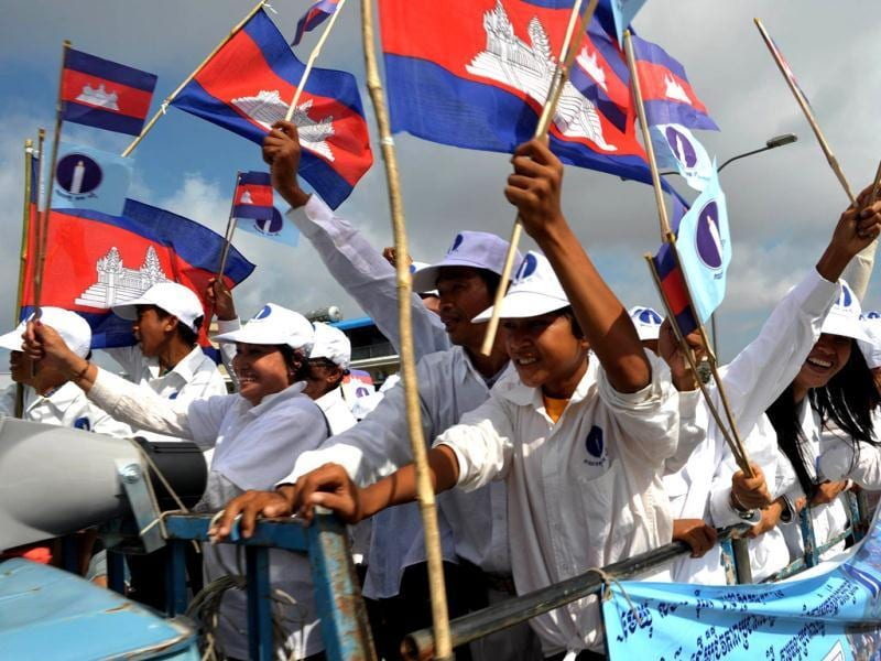 Cambodian supporters of the Sam Rainsy Party sit on a truck during the Commune Election campaign in Phnom Penh. AFP Photo/Tang Chhin Sothy