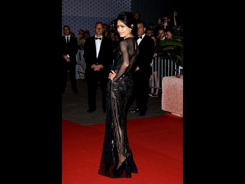 Freida Pinto carries the black outfit really well at opening night dinner at Cannes.