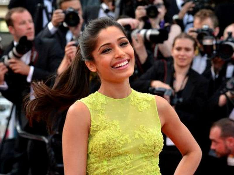 Freida Pinto is all smiles on Day 2 of the 65th Cannes Film Festival at the premiere of Rust & Bone (De Rouille et D'Os).
