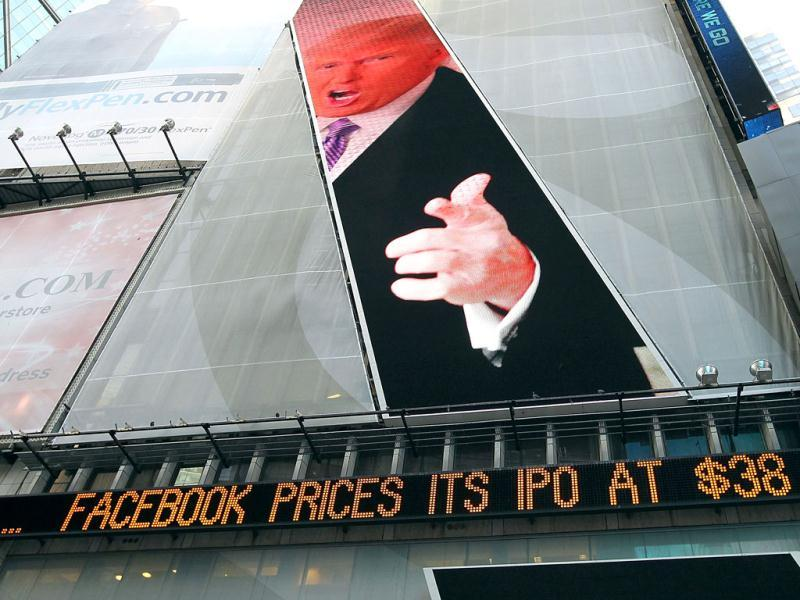An image of Donald Trump is seen above a message board that is announcing Facebook's IPO price in Times Squar in New York City. AFP/Justin Sullivan