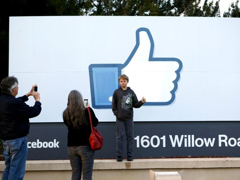 Xavier Schmidt of Menlo Park, has his picture taken by his parents outside Facebook's headquarters in Menlo Park, California, the night before the company's IPO launch. Reuters/Beck Diefenbach