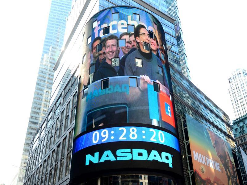 Facebook co-founder Mark Zukerberg is seen on a screen getting ready to ring the Nasdaq stock exchange opening bell in Times Square in New York. AFP/Emmanuel Dunand