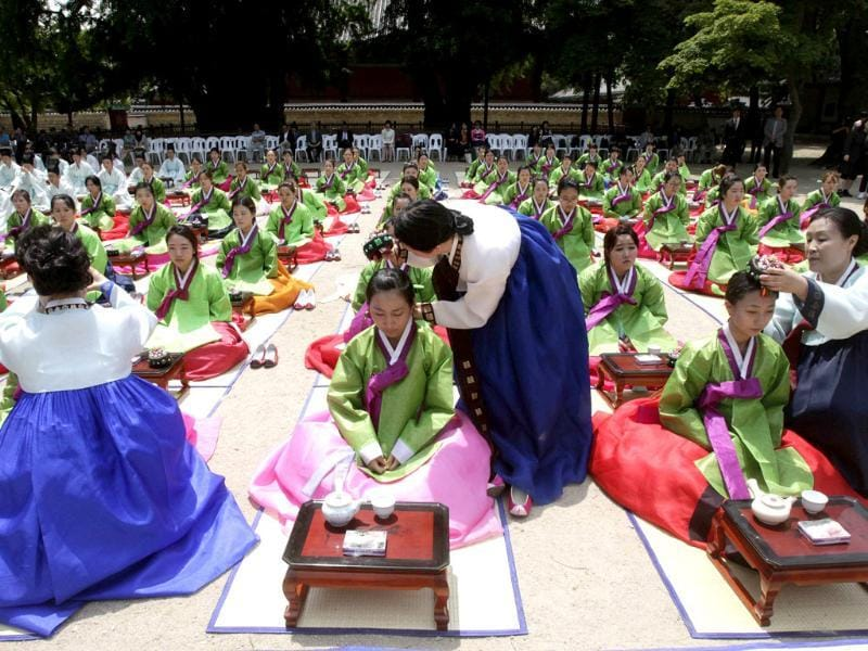 South Korean girls and boys in traditional dresses take part in the 40th Coming of Age Day Ceremony and re-presentation of traditional