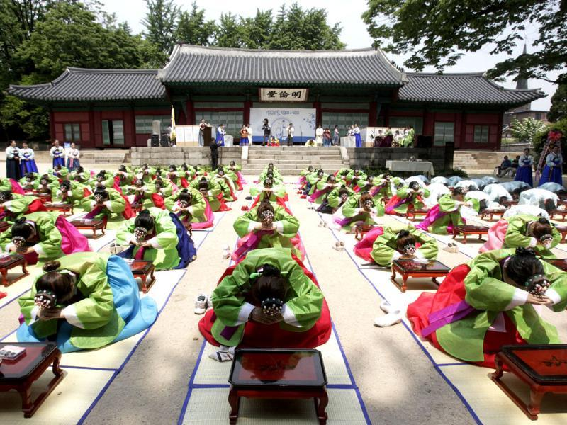 South Korean girls and boys in traditional dresses bow during the 40th Coming of Age Day Ceremony and re-presentation. AP/Ahn Young-joon