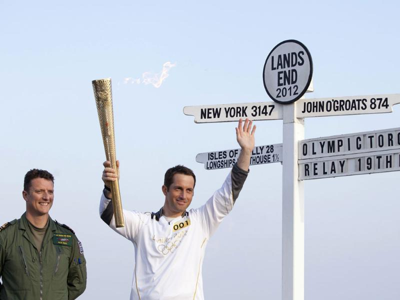 British Olympic sailing hero and three time gold medalist Ben Ainslie holds the Olympic torch at the official start of the London 2012 Olympic games torch relay, with Lt Cmdr Rich Full of the Royal Navy at Land's End, west of England. AP/Alastair Grant