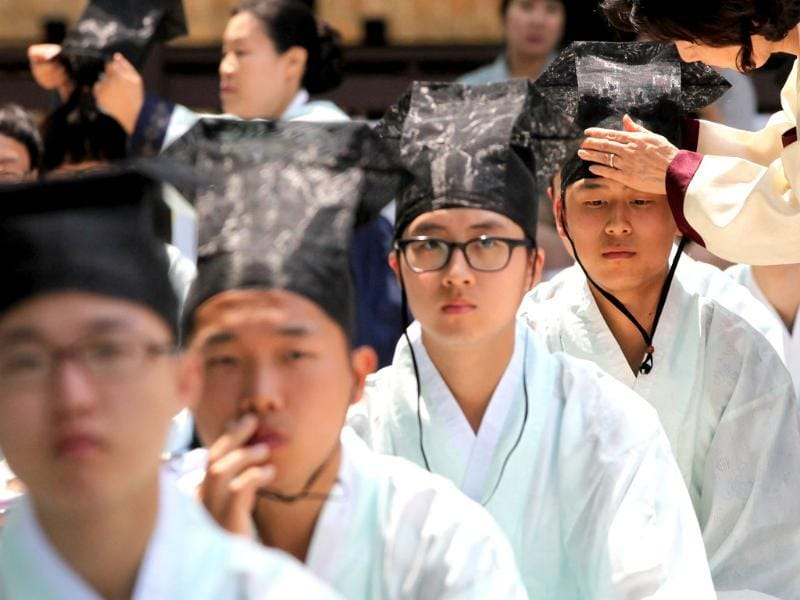 South Korean boys in traditional dresses take part in the 40th Coming of Age Day Ceremony and re-presentation of traditional