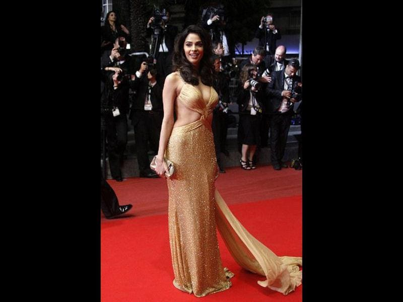 Mallika looks much glamourous as she flaunts her curves in yet another revealing dress at the 63rd Cannes Film Festival on May 18, 2010.