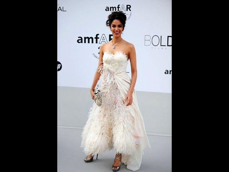 Mallika Sherawat in a white feather dress at the 64th Cannes Film Festival on May 19, 2011.