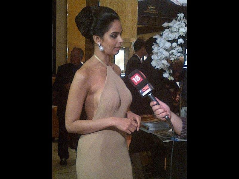 Mallika Sherawat looks hot in a revealing beige dress.