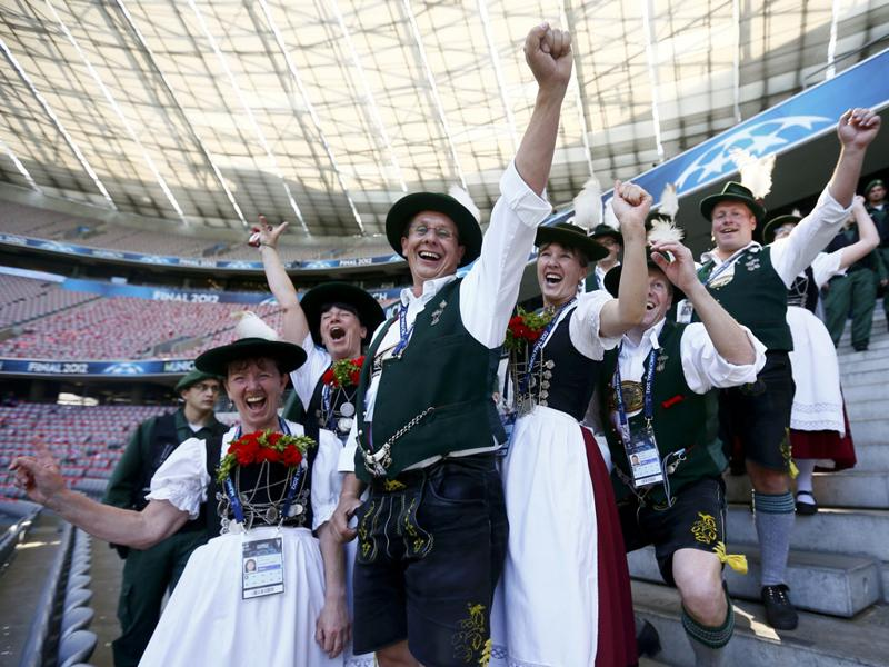 People in traditional Bavarian dresses pose for a photo at the Fussball Arena stadium in Munich, southern Germany, hours before the UEFA Champions League final football match FC Bayern Muenchen vs Chelsea FC. AFP/ Patrik Stollarz