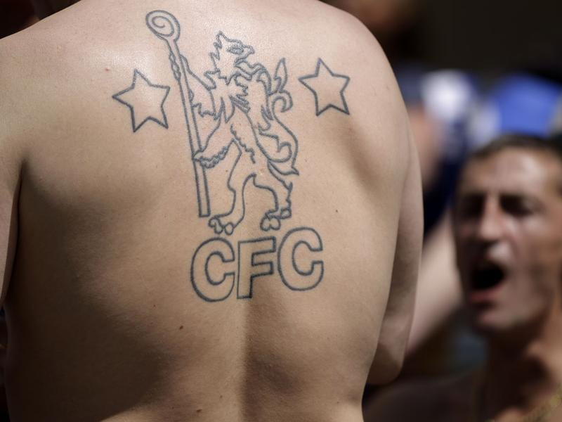 A Chelsea club crest adorns the back of a supporter as fans gathered on the streets of Munich, Germany Saturday. (AP Photo/Frank Augstein)