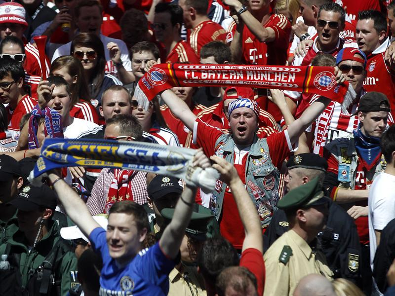 Bayern Munich and Chelsea fans, in blue, voice their support on the streets of Munich, Germany. (AP Photo/Matthias Schrader)