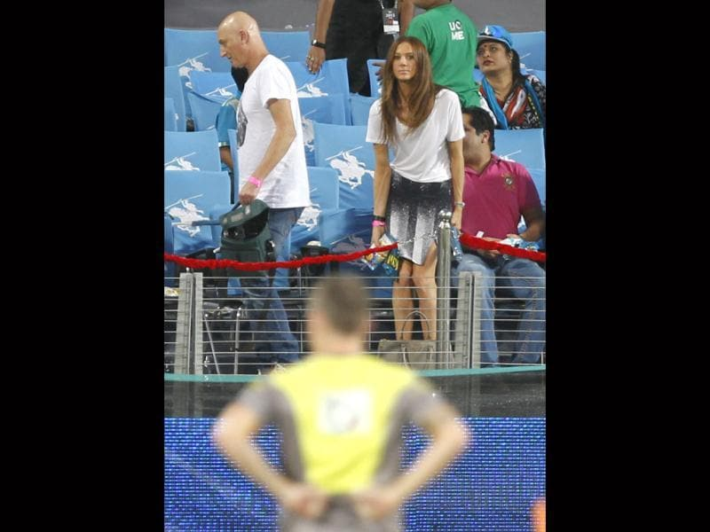 PWI batsman Michael Clarke's wife Kylie Boldy with an unidentified man during the match between Pune Warriors India and Kolkata Knight Riders at Subrata Roy Sahara Stadium in Pune. HT/Kunal Patil