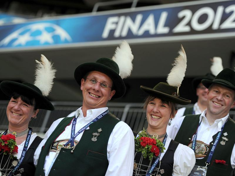 People in traditional Bavarian dresses pose for a photo at the Fussball Arena stadium in Munich, southern Germany. AFP/ Patrik Stollarz