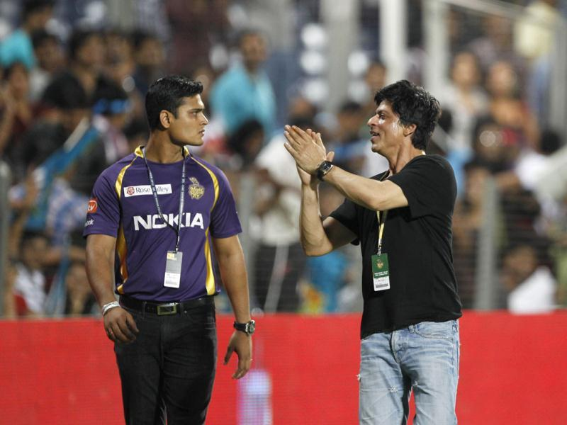 Kolkata Knight Riders co-owner Shah Rukh Khan cheers the crowd during the match between Pune Warriors India and Kolkata Knight Riders at Subrata Roy Sahara Stadium in Pune. HT Photo/Kunal Patil