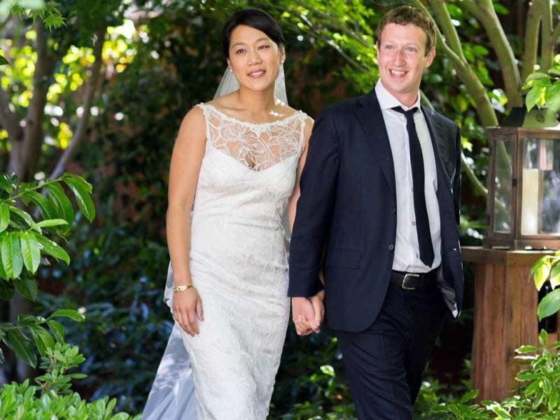 This photo provided by Facebook shows Facebook founder and CEO Mark Zuckerberg and Priscilla Chan at their wedding ceremony in Palo Alto, California. AP Photo/Facebook, Allyson Magda Photography