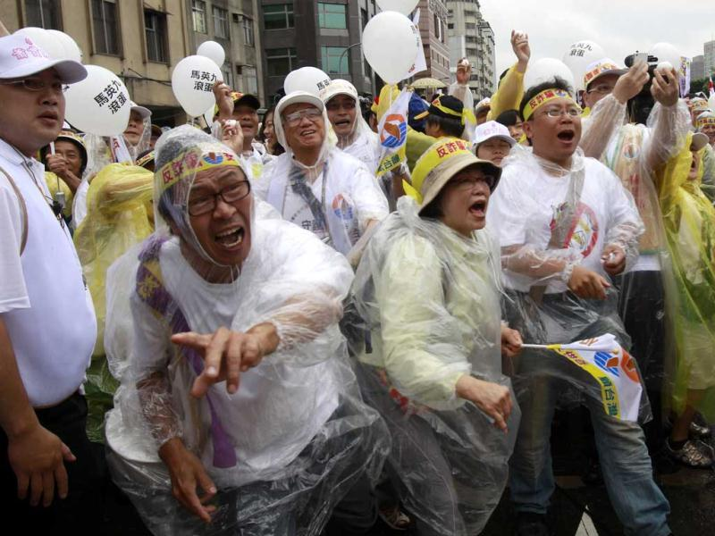 Protesters throw eggs at a portrait of Taiwan's President Ma Ying-jeou on his inauguration day, denouncing his policies, in Taipei, Taiwan. AP Photo/Wally Santana