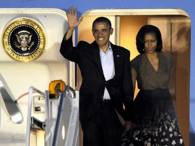 US President Barack Obama and first lady Michelle Obama arrive at Chicago O'Hare International Airport to attend the Nato Summit. AP Photo/Paul Beaty