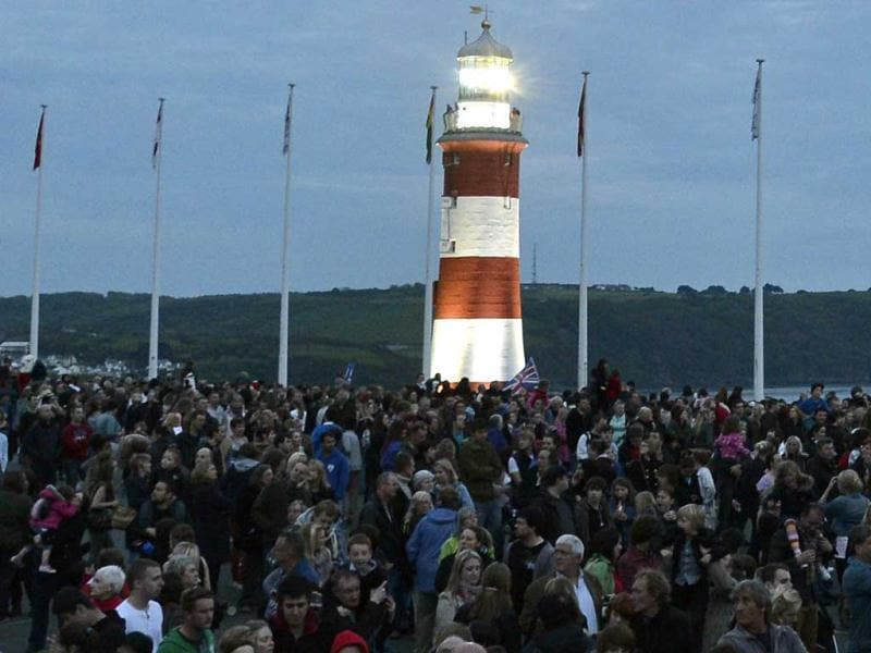 Large crowds gather before the Olympic torch arrives at Smeaton's Tower lighthouse at The Hoe in Plymouth, southwest England. Reuters/Toby Melville