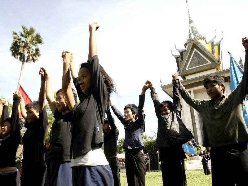 Cambodian students sing during the annual Day of Anger at Choeung Ek, a former Khmer Rouge