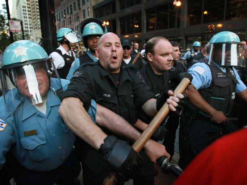 Police try to keep demonstrators from breaking through their lines durijng a march through the downtown streets in Chicago, Illinois. This was the sixth day of protests in front of the Nato Summit which runs May 20-21. Scott Olson/Getty Images/AFP