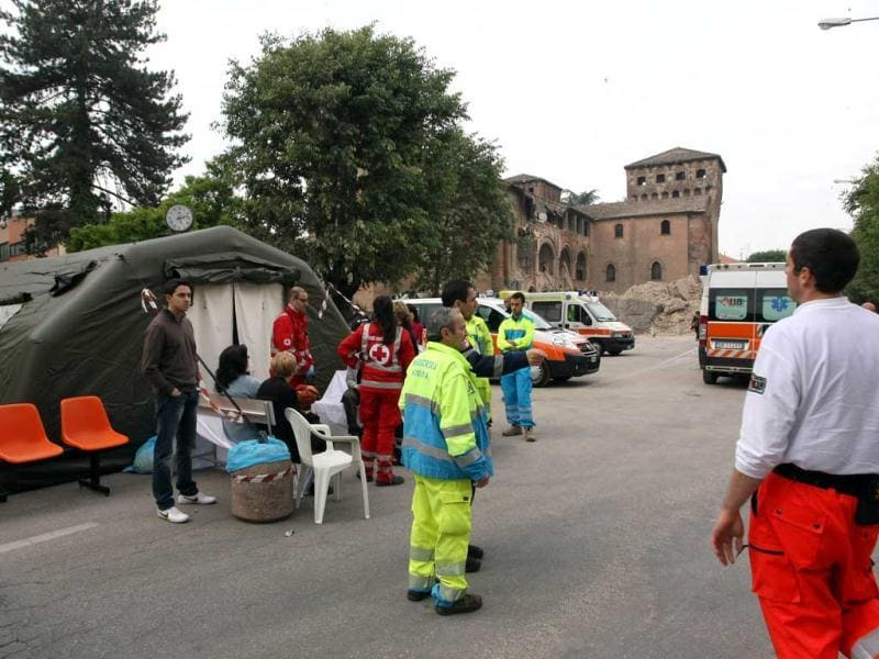 Rescue workers stand near the Castello delle Rocche, damaged during an earthquake in Finale Emilia, northern Italy. Panicked people rushed into the streets when a powerful earthquake shook northern Italy, killing three people and injuring at least 50. AFP/Pierre Teyssot