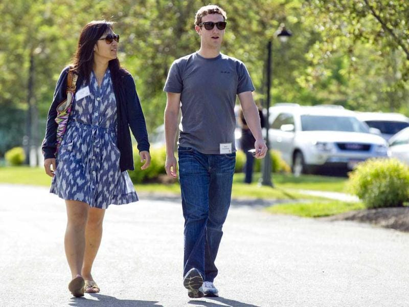Mark Zuckerberg, President and CEO of Facebook, walks to morning sessions with his girlfriend Priscilla Chan during the 2011 Allen and Co Sun Valley Conference, in Sun Valley, Idaho. (AP Photo/Julie Jacobson, Files)