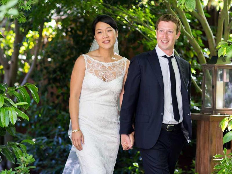 Facebook founder and CEO Mark Zuckerberg and Priscilla Chan at their wedding ceremony in Palo Alto, Calif. The ceremony took place in Zuckerberg's backyard before fewer than 100 guests, who all thought they were there to celebrate Chan's graduation. (AP Photo/Facebook, Allyson Magda Photography)